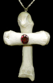 Human bone cross with garnet